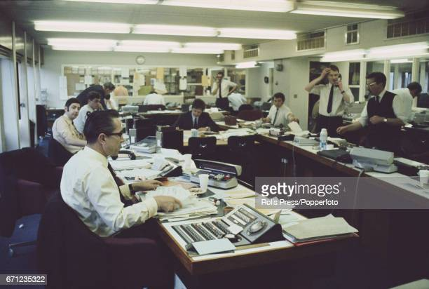 View of dealers and traders working in the foreign exchange room at Barclays Bank offices in the City of London in May 1971