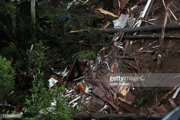 A view of debris field that was left in the wake of a home that was swept down a hill by a mudslide during a rain storm on February 14 2019 in...