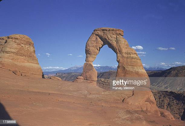 View of Delicate Arch sandstone rock formation at Arches National Park near Moab Utah 1960s