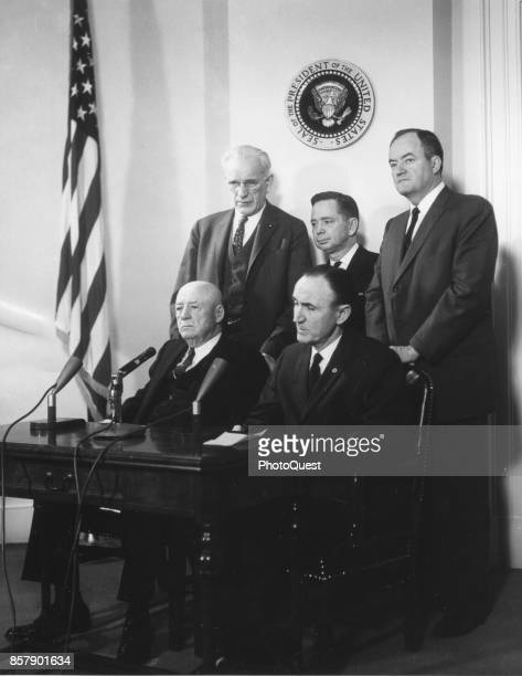 View of Democratic leaders of the 87th Congress behind microphones under the Presidential Seal Washington DC March 21 1961 Pictured are seated...