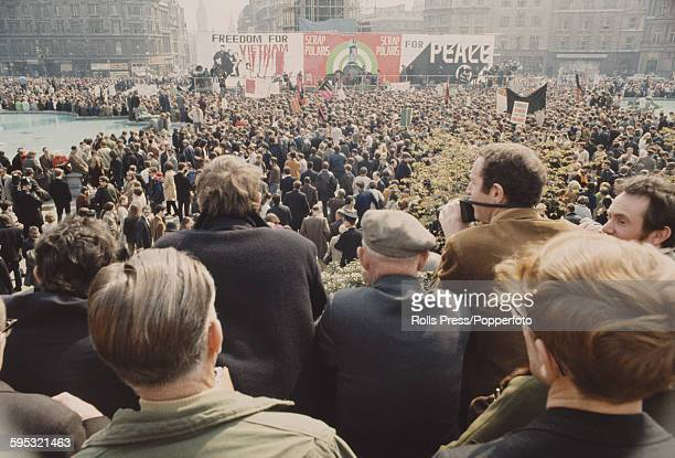 View of demonstrators and marchers attending a CND rally in Trafalgar Square following a march from Aldermaston to protest against American military...