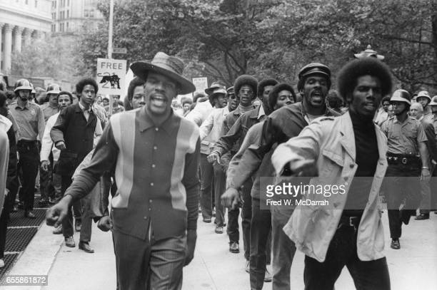 View of demonstrators as they at a protest outside the Federal courthouse to free the 'Panther 21' New York New York September 8 1970 The Panther 21...