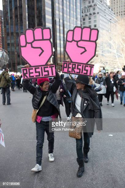 View of demonstrators both with signs at Columbus Circle during the Women's March on New York New York New York January 20 2018 Their signs feature...