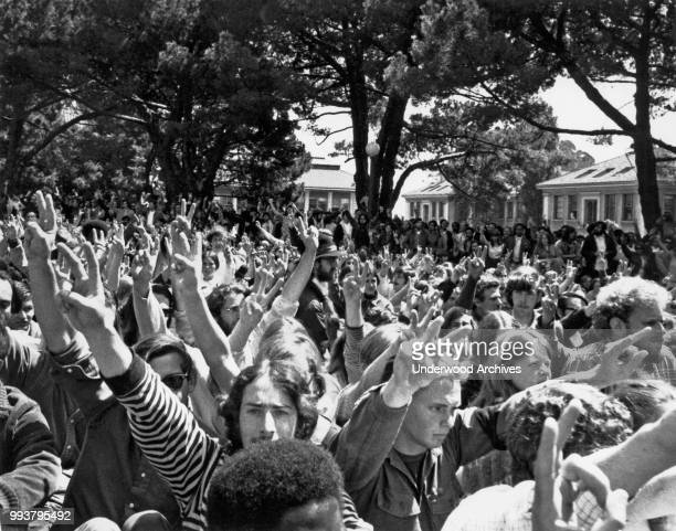 View of demonstrators, many making peace signs, during an anti-Vietnam War rally in People's Park, in front of the President's house at the...