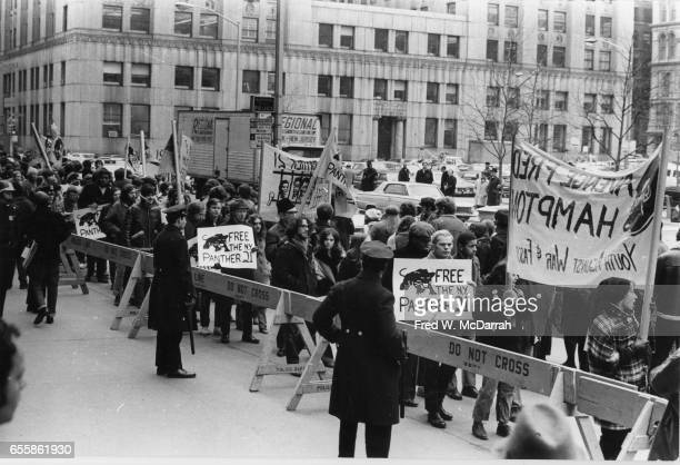 View of demonstrators many with signs as they at a protest outside the Federal courthouse to free the 'Panther 21' New York New York December 18 1969...