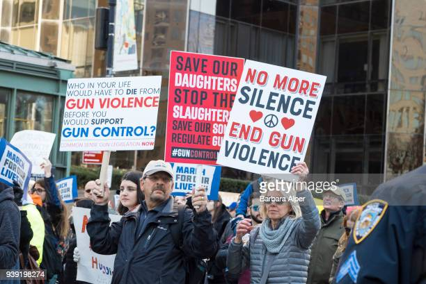 View of demonstrators many with signs as they participate in the March For Our Lives rally against gun violence near Columbus Circle New York New...