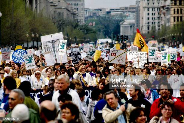 View of demonstrators many with signs during the March for Women's Lives Washington DC April 9 1989 Among the visible signs are ones that read 'Keep...