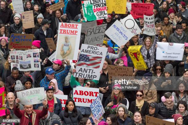 View of demonstrators many with signs during the Women's March on New York as they walk along 42nd Street New York New York January 21 2017 Among the...
