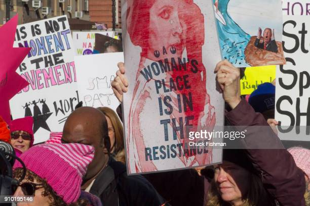View of demonstrators many with signs on Central Park West during the Women's March on New York New York New York January 20 2018 One holds a sign...