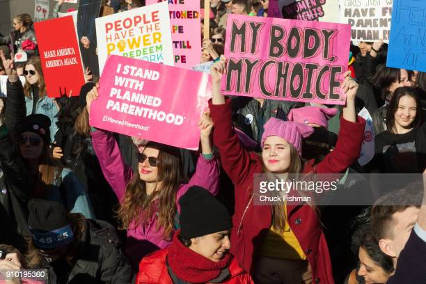 View of demonstrators, many with signs, on Central Park West during the Women's March on New York, New York, New York, January 20, 2018. Among the...