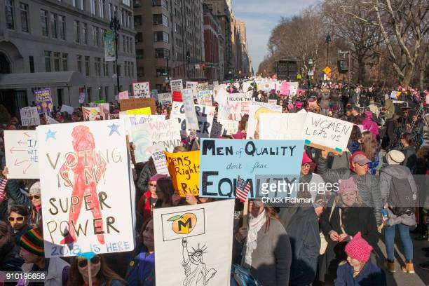 View of demonstrators many with signs on Central Park West during the Women's March on New York New York New York January 20 2018 Among the visible...