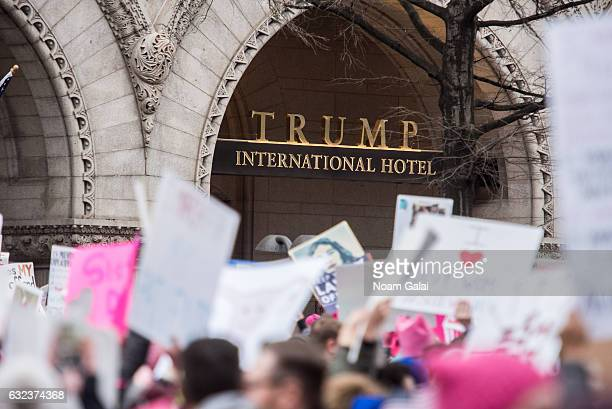 A view of demonstrators marching in front of the Trump International Hotel Washington DC on Pennsylvania Avenue during the Women's March on...