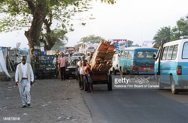 View of dense traffic on a busy street in Kinshasa, Democratic Republic of the Congo, 2003. Photo taken during the National Film Board of Canada's...
