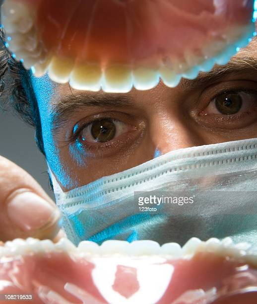 view of dentist examining teeth from open mouth - dental fear stock pictures, royalty-free photos & images
