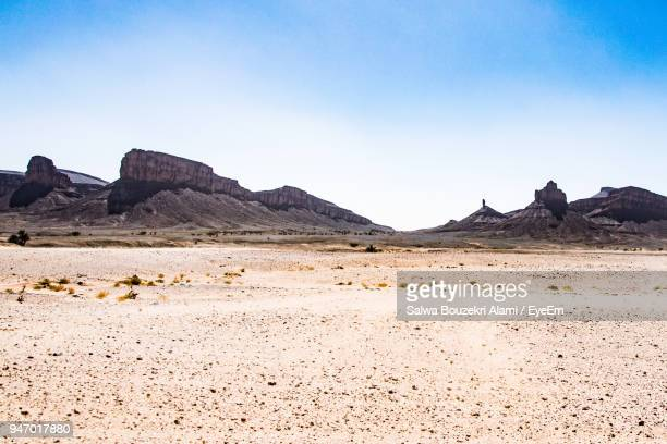 view of desert against blue sky - canyon stock pictures, royalty-free photos & images