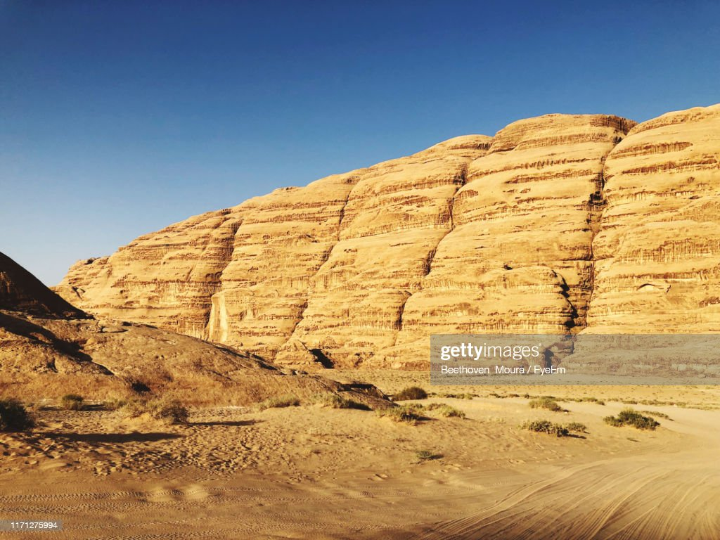 View Of Desert Against Clear Blue Sky : Stock Photo