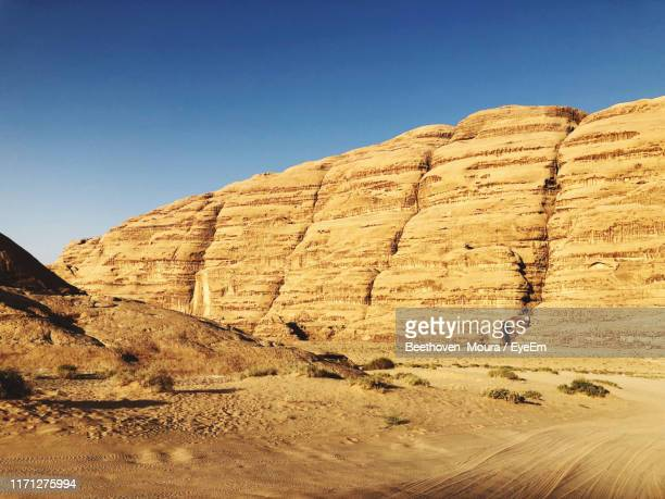view of desert against clear blue sky - moura stock photos and pictures