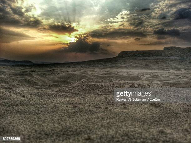 view of desert against cloudy sky - mecca stock pictures, royalty-free photos & images