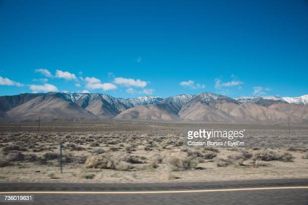 view of desert against cloudy sky - bortes stock pictures, royalty-free photos & images