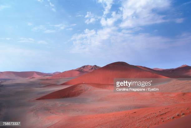 view of desert against cloudy sky - carolina fragapane stock pictures, royalty-free photos & images