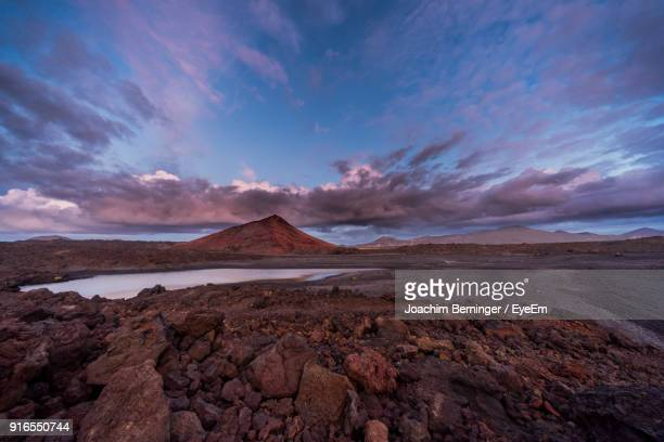 view of desert against cloudy sky - atlantic islands stock pictures, royalty-free photos & images
