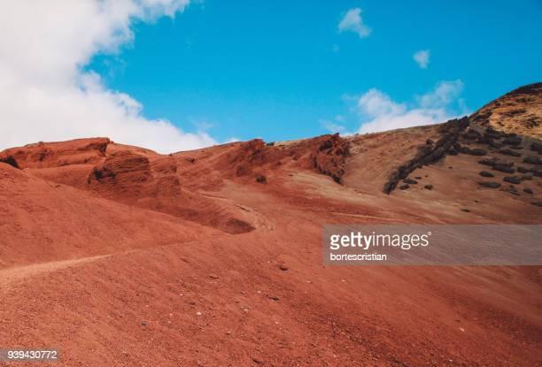 view of desert against cloudy sky - bortes photos et images de collection