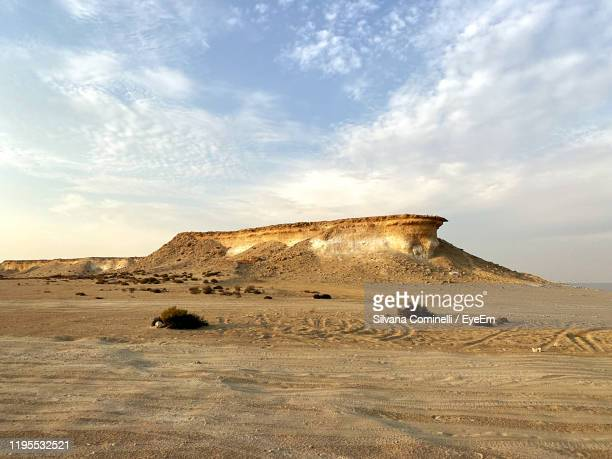 view of desert against sky - qatar stock pictures, royalty-free photos & images