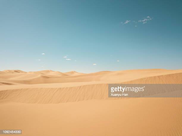 view of desert against sunny sky - desert stock pictures, royalty-free photos & images