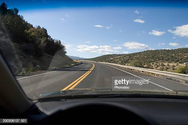 View of desert through car windscreen