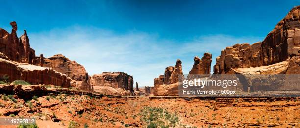 view of desert with rock formations - hank vermote stock pictures, royalty-free photos & images