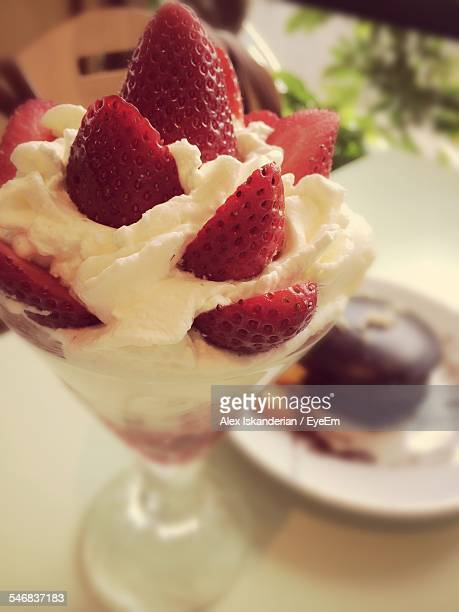 View Of Dessert With Strawberries And Whipped Cream