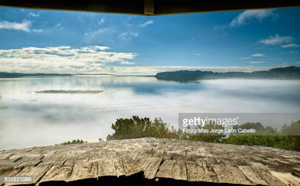 A view of Detif bay under fog in early summer morning from the road viewpont window.