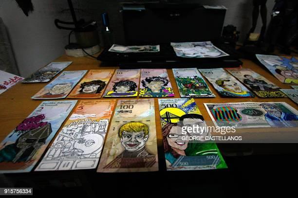 View of devalued Bolivar bills painted by Venezuelan illustrator Jose Leon at his workshop in San Cristobal, Venezuela on February 2, 2018. Using...