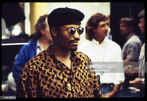 View of director John Singleton wearing sunglasses and beret while on the set of his movie 'Poetic Justice' Los Angeles CA 1993