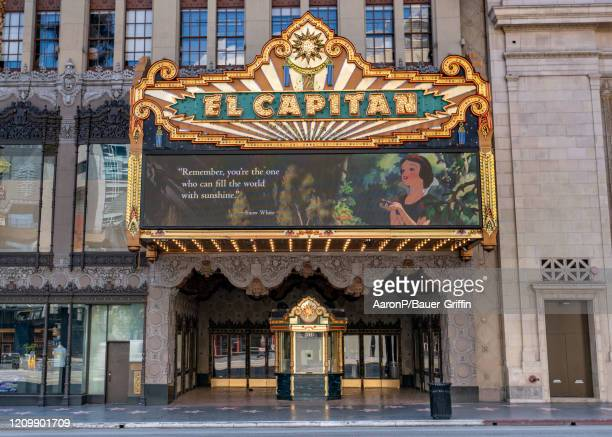 View of Disney's El Capitan Theatre with its updated marquee displaying inspiring messages from Disney characters like Dory, Peter Pan, Snow White...