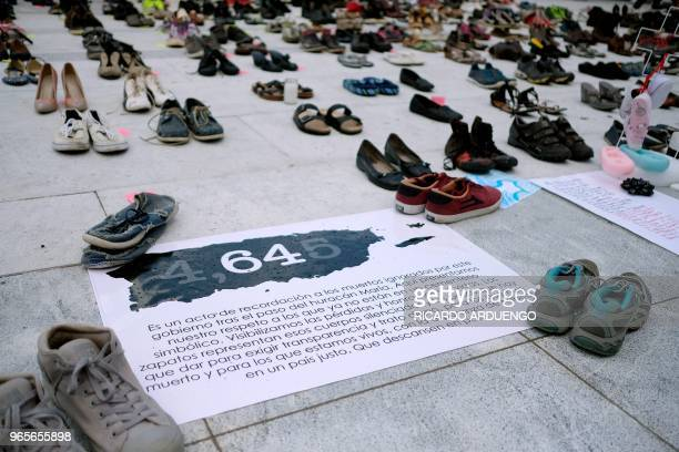 View of displayed shoes in memory of those killed by Hurricane Maria in front of the Puerto Rican Capitol in San Juan on June 1 2018 Hurricane Maria...
