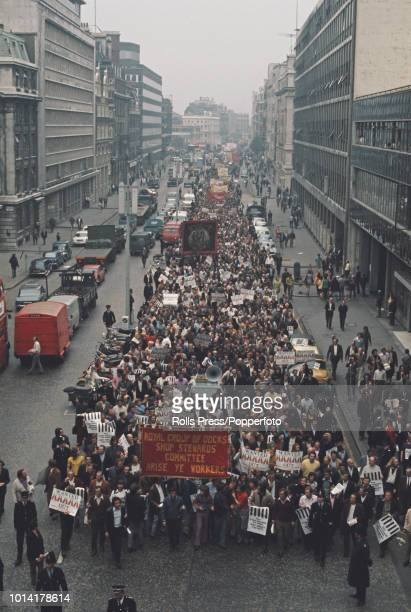 View of dockers and union members from the Transport and General workers Union marching along a street in London during a national dock strike in...