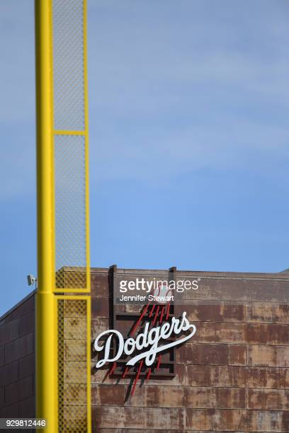 A view of Dodgers logo on a wall behind the left foul pole during the spring training game between the Cleveland Indians and Los Angeles Dodgers at...