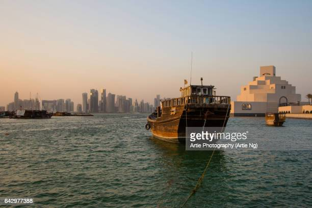 View of Doha Skyline Along Doha Bay With Traditional Dhow in the Foreground and Museum of Islamic Art on the Right, Doha, Qatar