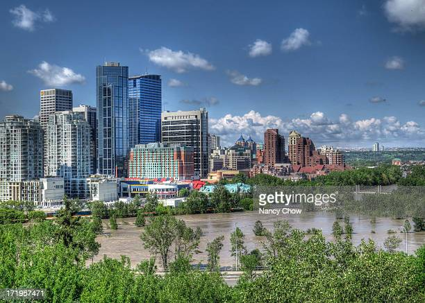 View of downtown Calgary and submerged Prince's Island Park on the right Tens of thousands of Calgarians were displaced by the largest flood in city...