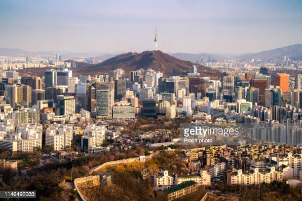view of downtown cityscape and seoul tower in seoul, south korea. - south korea stock pictures, royalty-free photos & images