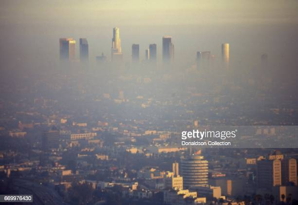 A view of downtown from Hollywood with the Capitol Records tower and lots of smog in the foreground in February 1995 in Los Angeles California