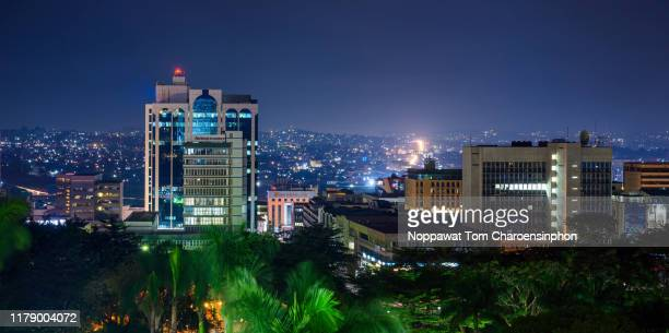 view of downtown kampala city at night, uganda, africa - kampala stock-fotos und bilder