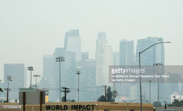 View of downtown Los Angeles looking north from the 10 freeway through the smoke from the Bobcat and the El Dorado fires with poor air quality in Los...