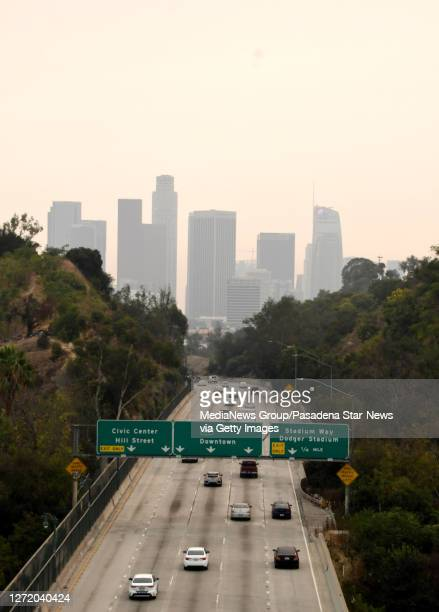 View of downtown Los Angeles looking south along the 110 freeway through the smoke from the Bobcat and the El Dorado fires with poor air quality in...