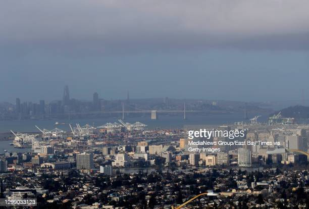 View of downtown Oakland and San Francisco are seen from Skyline Boulevard as clouds hang over after a rain and wind storm in Oakland, Calif., on...