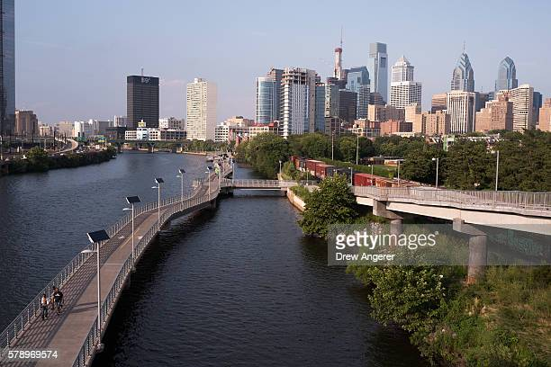 A view of downtown Philadelphia overlooking the Schuylkill River and Schuylkill Banks Boardwalk July 22 2016 in Philadelphia Pennsylvania The...