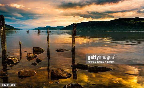 view of dramatic sky over lake - loch ness stock photos and pictures