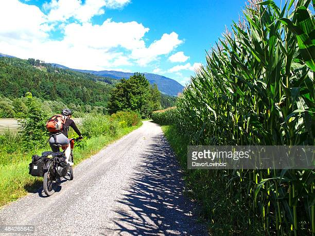 View of drau cycle path with biker near Spittal, Austria