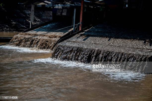 View of dredgers at the Madre de Dios River in Tacana indigenous territory, near Las Mercedes, La Paz department, Bolivia on August 31, 2019. - The...